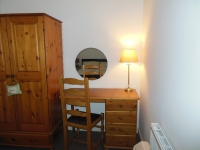 Double wardrobe with dressing table and lamp