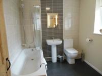 Modern spacious bathroom with under floor heating